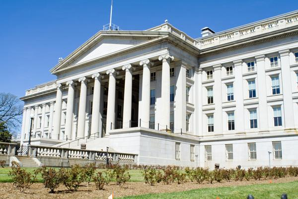 The U.S. Treasury Department said Monday it will auction off the Troubled Asset Relief Program investments it has in 12 U.S. banks, including the $35.5 million it loaned to Los Alamos National Bank. Pictured is the U.S. Treasury Department building.