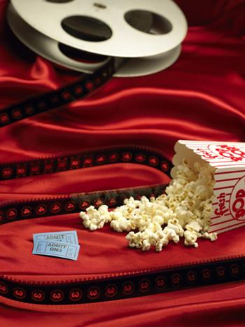 Dickinson Theaters Inc. will settle a class-action lawsuit by paying as much as $1.5 million in popcorn.