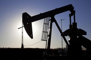Raymond James on Monday downgraded 10 oil services companies, many of which are based in or have a large presence in Houston, the Associated Press reports.