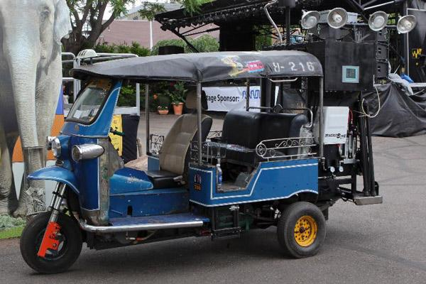 """Remember when the DeLorean of the future ran on trash in the film """"Back to the Future?"""" Now just combine that with some animal poo, and Voila!, you have a poo-powered Tuk Tuk."""