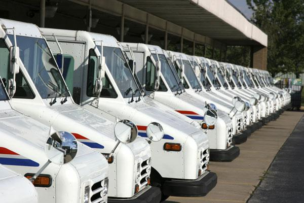 The U.S. Postal Service is required by law to pay the federal government on Sunday $5.6 billion to fund health care benefits for retirees.