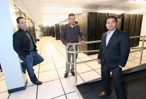 From left, Sage Technology Partners Inc. President Jared Logan, Vice President Ben Mroczek and CTO Ram Basnet at OSO Technologies' data storage center in Albuquerque, where Sage stores its systems for cyber security monitoring and defense services.