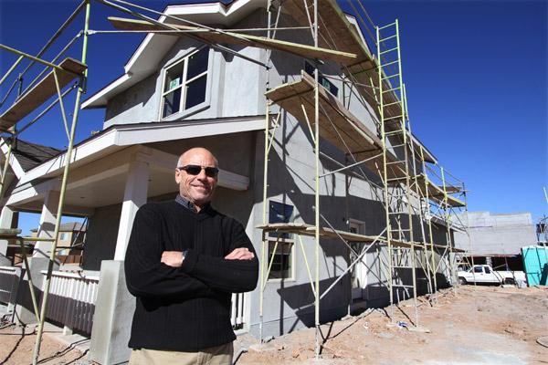 Home Builders Association of Central New Mexico Executive Vice President Jim Folkman, pictured at a new home under construction at Mesa del Sol, thinks Albuquerque will see 1,400 home starts this year.