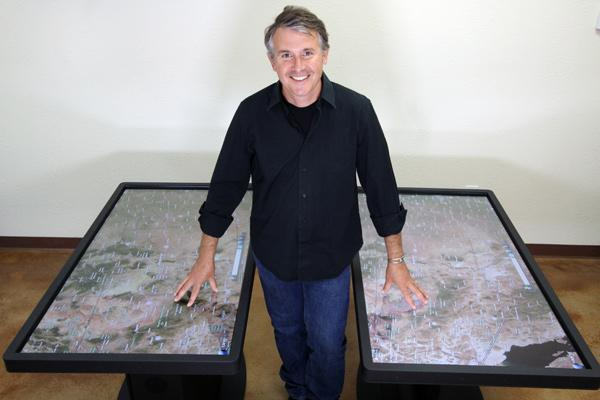 Jim Spadaccini displays Ideum's fourth generation multi-touch tables, whose graphic performance has been improved five-fold, he says.
