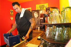 Armando Valenzuela works at Route 66 Malt Shop on Central Avenue Southeast in Albuquerque's Nob Hill. Route 66 owner Eric Szeman says the new Albuquerque minimum wage law will cause his payroll to skyrocket, presenting a dilemma on how to meet the costs.