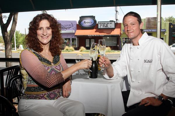 Scalo's General Manager Elaine Blanco and Executive Chef Garrick Mendoza hoist a toast inside the Italian grill. Andre's in the background is slated to become Elaine's.