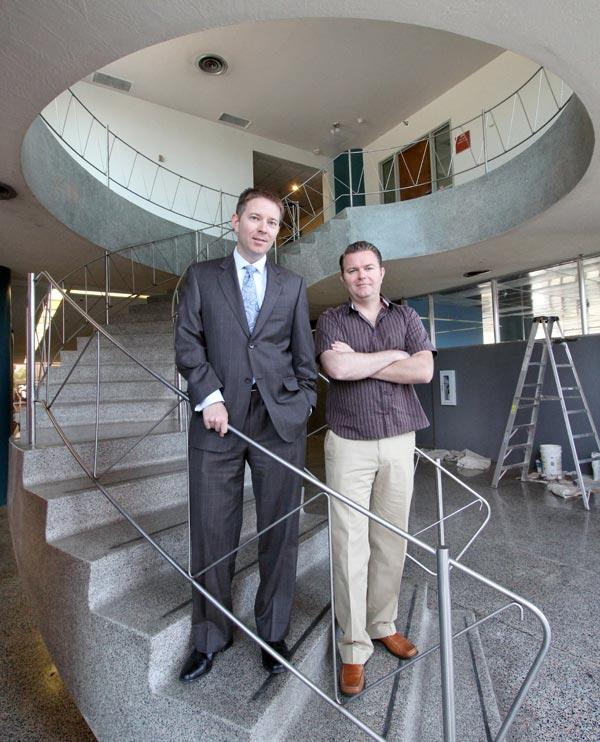 Doug Peterson of Peterson Properties, left, and brother J.C. Peterson are pictured in Downtown's Simms Building. Peterson Properties has launched a $5 million renovation of the building, its first major upgrade.