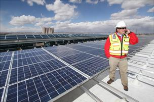 Affordable Solar Operations' Manager Blake Richards visits a solar array the company is installing on top of the Albuquerque International Sunport's parking structure.