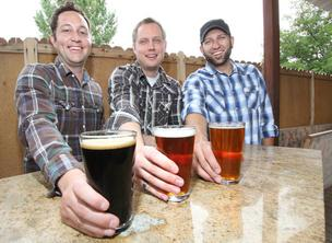 Bosque Brewing's founders, from left, Gabe Jensen, Kevin Jameson and Jotham Michnovicz, try out the brews at a local pub. The three plan to open their modest Northeast Heights brewery this summer after spending two-plus years in training.