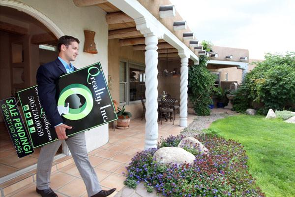 John Kynor of Q Realty, pictured at a home the company is selling in Albuquerque's Northeast Heights, is one of several local real estate brokers who have opened their own shops as the residential market begins to recover.