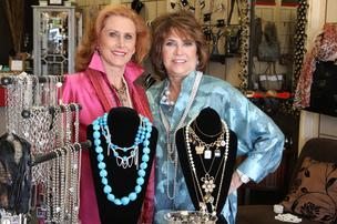 From left, Patty Puhl and Berdel Boulanger built their business, Silk Road Connection, on a love of travel and fashion. Teaming up with other local companies on marketing endeavors and holding charity fundraisers have helped Puhl and Boulanger grow business.