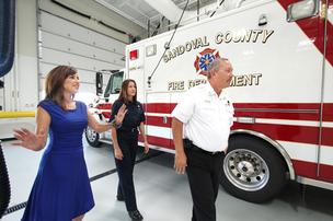 Tiffany Gaede, left, of AIC General Contractor tours the new fire station at Santa Ana Pueblo with firefighter/paramedic Shannon Farrell, center, and deputy chief Jess Lewis, right. AIC built the fire station, designed by WHPacific. Gaede says tribes award contracts based on loyalty and trust with the parties involved.