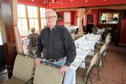 Michael O'Reilly, owner of Pranzo Italian Grill in Santa Fe, tweaked his menu and created a new upstairs restaurant, Alto, that serves smaller portions at lower prices. He says customers are driving the trend toward lower prices.