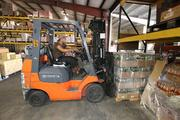 Working the forklift is warehouse worker Abraham Miranda.