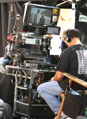 """Crew members work on site of """"In Plain Sight,"""" which wrapped up production in 2012."""