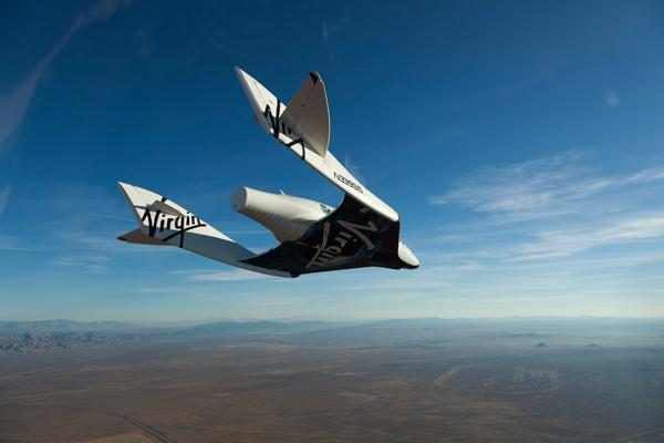 Virgin Galactic's SpaceShipTwo is shown in glide flight. As the company moves toward launching tourists into space, it's also working to get a bill passed in New Mexico that would limit spaceport suppliers' liability.