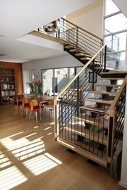 Doug Turner's home, designed by Treveston Elliott and built by Gary Smith of Second Generation Construction, has a floating staircase made of oak.