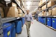 Vitality Works President and CEO, Mitch Coven, walks through the warehouse.
