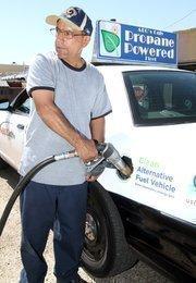 Mechanic Mark Esquibel fuels up