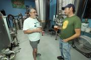 Turtle Mountain Brewing Co. Brewer Bill Krostag (left) talks with General Manager Adam Galarneau.