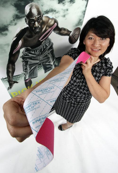 Kinesio USA has moved its manufacturing from Japan to Albuquerque to produce its Kinesio Tex Tape. Pictured is Tomoko Kase, Kinesio vice president.