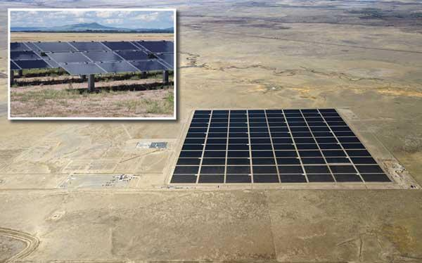 The state's first utility-scale solar electric plant near Cimarron in northeastern New Mexico, shown here in an aerial view, came fully on line in December. The inset photo shows a close-up view of the solar panels at the plant.
