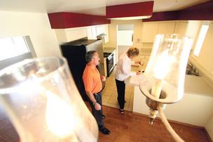 Tom Schmidt (l) and Meg Shultz inspect a vacant NE Heights home.