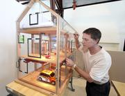 Mark Pyszkowski, Central New Mexico Community College's business account representative, examines the interior of the house of pressure, at the CNM solar thermal weatherization lab.
