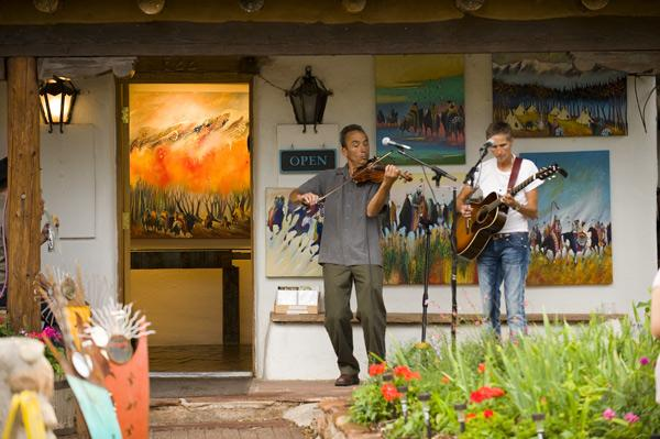 Musicians are a frequent sight during openings and arts crawls on Canyon Road, the legendary street in Santa Fe that's home to 125 art galleries.