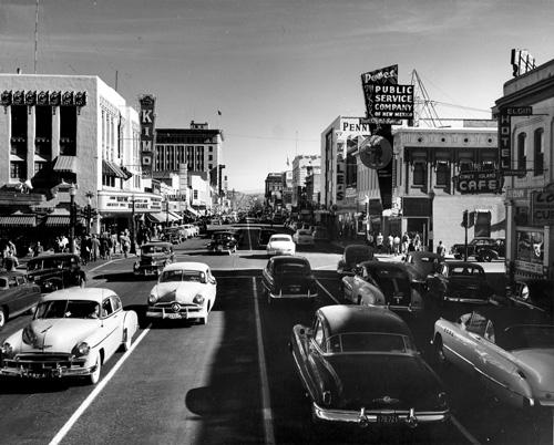 This photo looks east down a bustling Central Avenue around 1950. Visible landmarks include the KiMo Theatre and Public Service Co. of New Mexico offices.