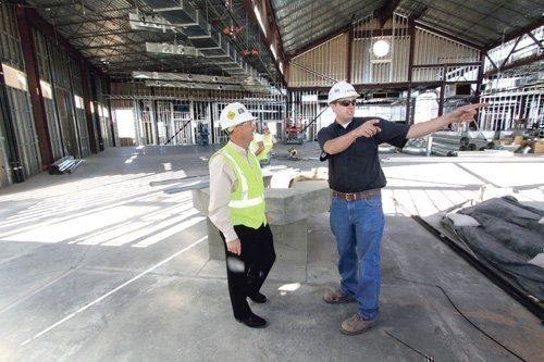 Klinger Constructors LLC CEO Tom Novak, left, and Superintendent Alan White discuss construction work at St. Jude Thaddeus Catholic Church on Paradise Boulevard NW.