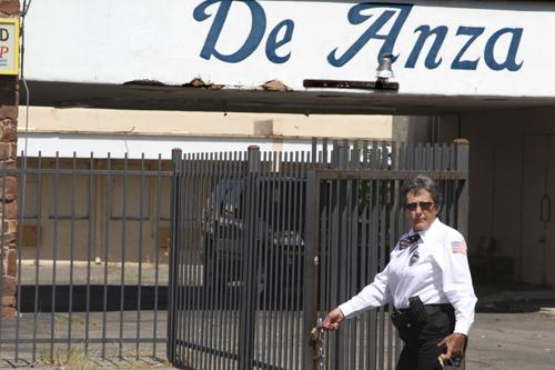 A security guard hired by the city of Albuquerque locks the gate at the vacant De Anza Motor Lodge at 4301 Central Ave. N.E.