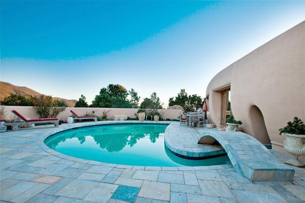 The only adobe home architect Frank Lloyd Wright ever designed is for sale in Santa Fe for $4.75 million. The 5-bedroom, 7+ acre home comes with a half-moon-shaped pool. See two more photos of the residence by clicking on the above photo.