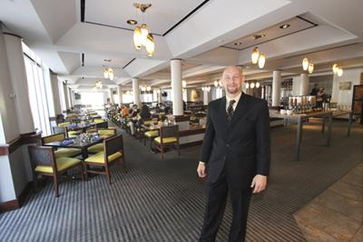 Daniel Kuperschmid, general manager of the Hyatt Regency Albuquerque, in the hotel's revamped Forque restaurant. It's part of $2 million in renovations under way at the Downtown hotel.