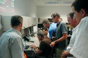 Researchers from LANL and the French Space Agency examine data from the Mars Science Laboratory Curiosity Rover Aug. 6, after the rover landed on Mars.
