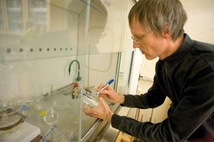 New Mexico Highlands University chemistry professor Merritt Helvenston works in the laboratory. NMHU is pursuing contracts with the U.S. Department of Defense and NASA to use a process that Helvenston developed to remediate hydrazine, a highly toxic chemical that is frequently used as a propellant in some jets and space vehicles.