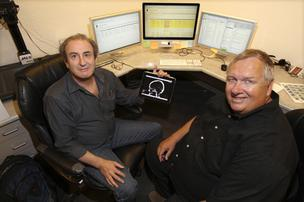 Net Medical Xpress Solutions' CEO Dick Govatski, right, and collaborator William Bernstein, display the company's software imaging technology. Focusing on medical software helped Net Medical grow revenue two-fold since 2006.