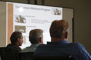Business Environment employees listen to Nuvita's presentation about its health and wellness program. About 5,000 are enrolled in the Albuquerque company's workplace programs