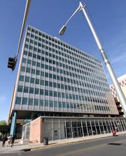 The 13-story Simms Building was bought earlier this year by Peterson Properties for $1.7 million.