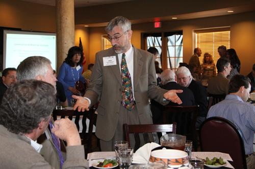 Ken Simonson (standing) speaks with attendees at ACG New Mexico Building Branch's Feb. 15 luncheon.
