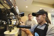 The Coffee Shop Manager Tyler Tencza observes as trainee server Erica Tafoya prepares one of the shop's caffeinated blends.