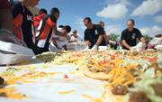 """To coincide with the state's Billy the Kid-themed """"Catch the Kid"""" tourism promotion, Gallup created a new event called Wild West Day, where events included the making of what was billed as the world's largest Navajo taco."""