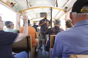 "Michael Silva of ABQ Trolley Co. speaks with passengers, while business partner Jesse Herron drives. The company designed tours that would appeal to both visitors and locals, including specialized tours about film sites and ""haunted"" sites."