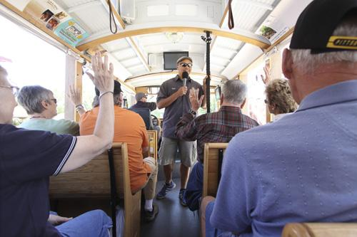 """Michael Silva of ABQ Trolley Co. speaks with passengers, while business partner Jesse Herron drives. The company designed tours that would appeal to both visitors and locals, including specialized tours about film sites and """"haunted"""" sites."""