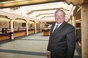 Bill Enloe inside Los Alamos National Bank.