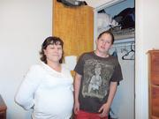 Isaias and her son Adrian, stand next to an empty closet.