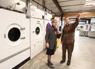 Enchantment Land Certified Development Co. loan officer June Crain Griffy speaks with Scott Ciener of Luna Laundry in Santa Fe, an ELCDC client. Funding from ELCDC and New Mexico Bank & Trust was used to purchase Luna's new facility, pictured.