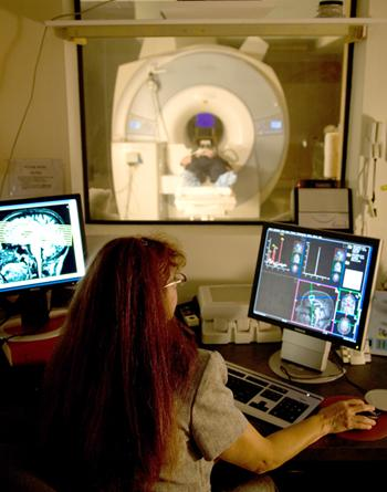 A technician at the MIND Research Network in Albuquerque conducts an MRI (magnetic resonance imaging) brain scan on a patient.