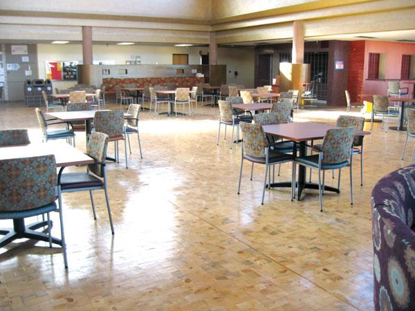 Old Wood LLC used burnt and crushed trees harvested from Dixon's Apple Orchard near Cochiti Lake to build this floor at the Santa Fe Community College student center.