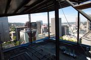 A view to the north from the old roof of the Edith Green-Wendell Wyatt federal office building. Renovations include a new canopy, shown at the top in this photo, that will hold a solar electric array and gutter system to harvest rainwater for use in the building's toilets.